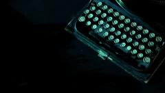 Old typewriter track from above with projector typing - stock footage