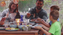 Group of people eating outdoors in summer. Shot on RED EPIC for high quality 4K, Arkistovideo