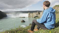 Hiking Iceland tourist at waterfall Godafoss l visiting tourist attractions Stock Footage