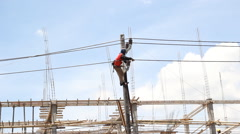 Footage Electricity Authority on electricity post to repair a cable Stock Footage