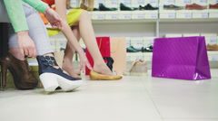 Young women trying on shoes Stock Footage