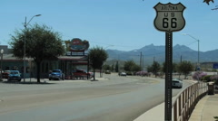 Time lapse of historic route 66 road sign with cars driving by Arizona Stock Footage