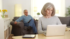 Stock Video Footage of Mature adults using laptop computer