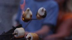Mother and son roasting marshmallows by outdoor fire. Shot on RED EPIC for high - stock footage