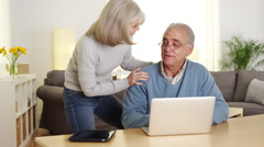 Mature adults learning how to use laptop computer together - stock footage