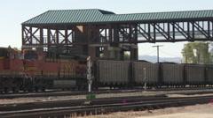 Wide shot of a coal train rolling through Missoula, Montana Stock Footage