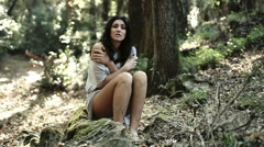 beautiful scared woman in the woods horror movie - stock footage
