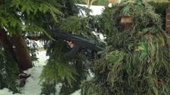 Soldier in ghillie suit gun Stock Footage