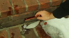 Secret hidden key under brick Stock Footage