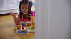 Young girl playing with toy. Shot on RED EPIC for high quality 4K, UHD, Ultra HD Stock Footage