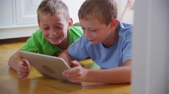 Two young boys using digital tablet together. Shot on RED EPIC for high quality Stock Footage