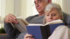 Mature couple reading books Stock Footage