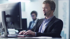 Customer Service Operator at Work in Call Center 2 Arkistovideo