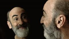 Bearded old man mirror smirk sneer faces Stock Footage