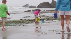 Children playing at beach. Shot on RED EPIC for high quality 4K, UHD, Ultra HD Stock Footage