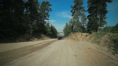 Two truckloads of sand had left on a forest road, a sand pit with trucks. severa Stock Footage