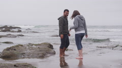 Couple walking at beach together. Shot on RED EPIC for high quality 4K, UHD, Stock Footage