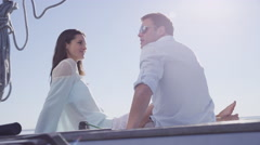 Young couple sit on sailboat together. Shot on RED EPIC for high quality 4K, Stock Footage