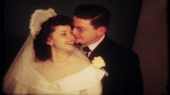 1758 - newlyweds pose for the camera after ceremony - vintage film home movie Stock Footage