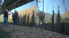 Visitors look at names on Vietnam Wall That Heals. Stock Footage