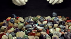 Woman's hands are selecting sodalite stones Stock Footage