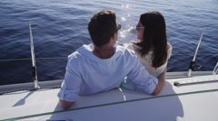 Young couple on sailboat together. Shot on RED EPIC for high quality 4K, UHD, Stock Footage