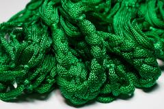 Green spool of thread - abstract background. Stock Photos