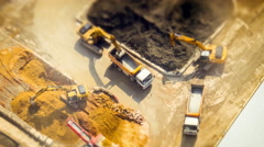 Excavators and tipper tracks at construction. Hong Kong. Time lapse, tilt shift Stock Footage
