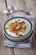 Rice pudding with nectarines and roasted almond sliver Stock Photos