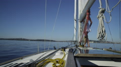 Young woman walking on sailboat. Shot on RED EPIC for high quality 4K, UHD, - stock footage