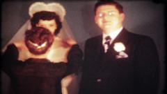 1756 - newlyweds prepare for photos after ceremony - vintage film home movie Stock Footage