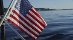 American flag waves on back of sailboat. Shot on RED EPIC for high quality 4K, - stock footage