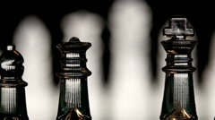 4K. Glass chess dynamic change of focus. Hand transposes pawns Stock Footage