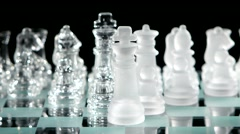 4K. Glass chess on chessboard - stock footage
