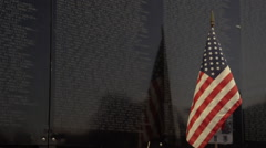 Close up of flag next to Vietnam Wall That Heals. Stock Footage