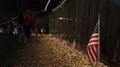 Close up of flag with people in the background at Vietnam Wall That Heals. Stock Footage