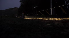 Nighttime wide shot of Vietnam Wall That Heals. Stock Footage