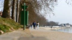 People walking By The River Side - Autumn Atmosphere - Leaves Falling - Timel - stock footage