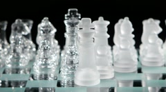Glass chess on chessboard Stock Footage
