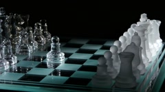 Beautiful pieces on the chessboard. black background - stock footage