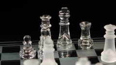 Falling pieces on the chessboard, black background Stock Footage