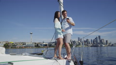 Young couple on sailboat together. Shot on RED EPIC for high quality 4K, UHD, - stock footage
