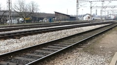 Railway - Train Station - Railways - Railroad With A Man In The Background - stock footage