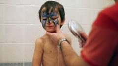 Young father, trying to wash his little boys face Stock Footage