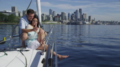 Young couple on sailboat together using cell phone. Shot on RED EPIC for high - stock footage
