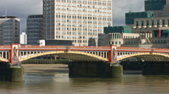 Vauxhall Bridge London 4K pan to MI6 building Stock Footage
