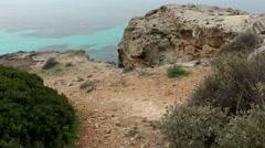 Spain Mallorca Island Cala Blava 015 on a rocky plateau at shore Stock Footage