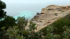 Spain Mallorca Island Cala Blava 014 rocky plateau with Mediterranean vegetation Stock Footage