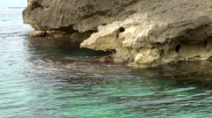 Spain Mallorca Island Cala Blava 003 rugged rock in turquoise water Stock Footage