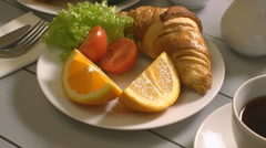 Breakfast with croissant, tomato end tea Stock Footage